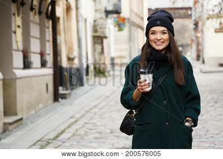 Happy Young Woman Wearing In Green Jacket On The Street