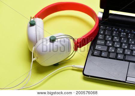 Music And Digital Equipment Concept. Earphones Made Of Plastic