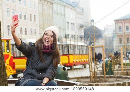 Laughing Young Woman Taking Selfie On Smart Phone
