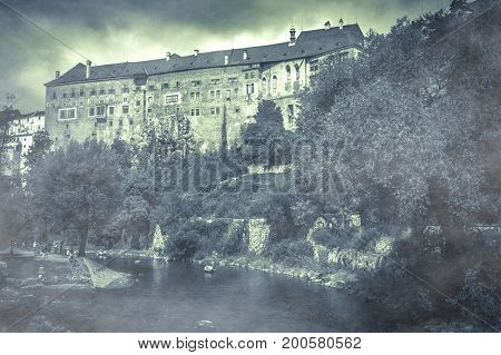 Surreal atmosphere at the Cesky Krumlov castle with fog on autumnal day