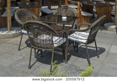 View of cosy nook for summer relaxation with table, chair and wooden bench, park  Borisova gradina, Sofia, Bulgaria