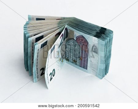 Stack Of Banknotes Worth 20 Euro Isolated On A  White Background