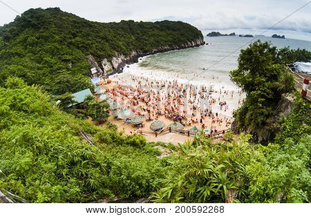 overcrowded beach in Cat Island - it is a popular summer destination for Vietnamese tourists poster