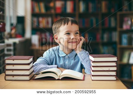 Smiling Boy With Books