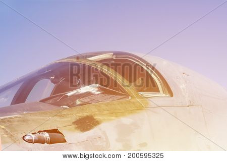 Airforce background. Fighter jet cabin close-up view in sun light.