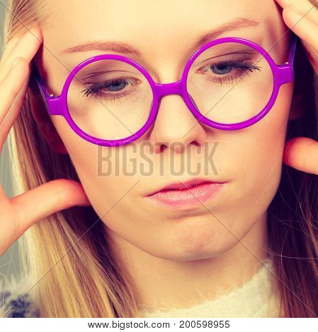 Nerdy Woman In Big Holding Head