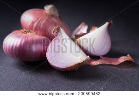 sliced red onions on black stone background vegetable for cooking food