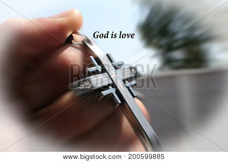 God is love with cross in hand high Quality