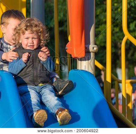 Two Brothers On The Playground