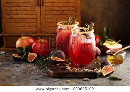 Fall or winter sangria with fig, cinnamon, apples and honey