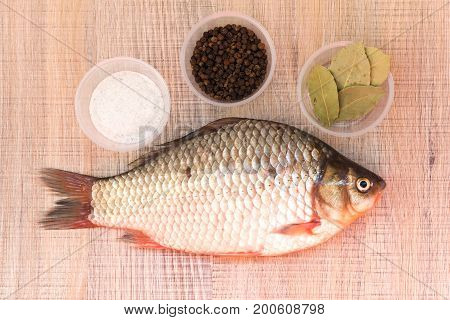 Fresh Fish Carp On The Spice Lies On The Board And The Plate