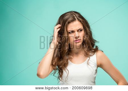 The young woman's portrait with sad emotions at studio
