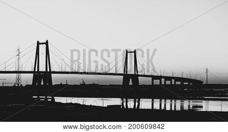 Black and White silhouette of the large suspension concrete bridge near Figueira da Foz Portugal