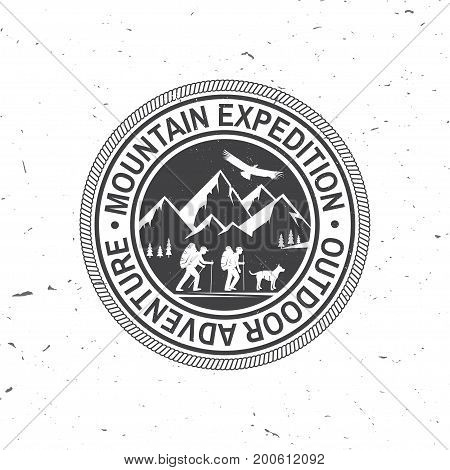 Mountain expedition badge. Vector illustration. Concept for shirt or logo, print, stamp or tee. Vintage typography design with mountaineers and mountain silhouette. Outdoors adventure emblem.