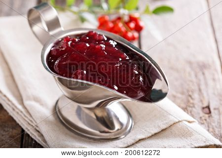 Cranberry sauce for Thanksgiving in a metal sauce dish