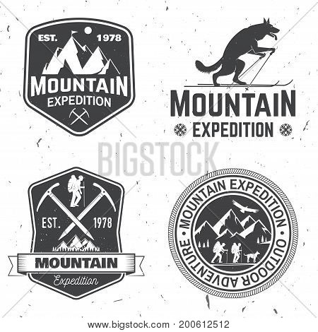 Set of mountain expedition badges. Vector illustration. Concept for shirt or logo, print, stamp or tee. Vintage typography design with mountaineers and mountain silhouette. Outdoors adventure emblems.