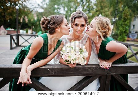 Fabulous Bride Walking, Posing And Having Fun With Her Bridesmaids In The Downtown On A Wedding Day.