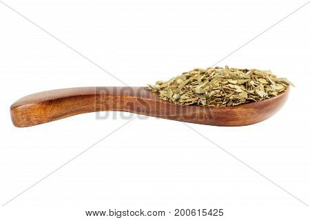 Yerba mate in a wooden boat not against white background