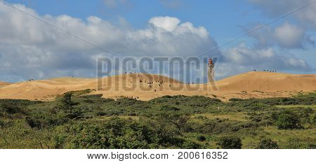 Old lighthouse and Rubjerg Knude. High sand dune at the west coast of Denmark.
