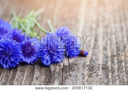 Cornflower Blue Flowers (centaurea Cyanus) On An Old Wooden Table