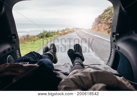 Couple Lying In The Car Trunk