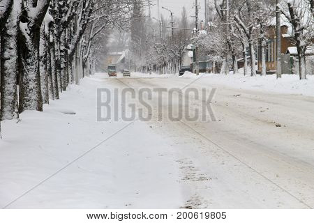 Slippery road after snowfall in a city