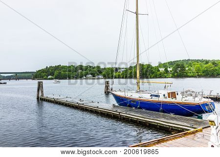Belfast, Usa - June 9, 2017: Empty Marina Harbor In Small Village In Maine During Rain With Boats An