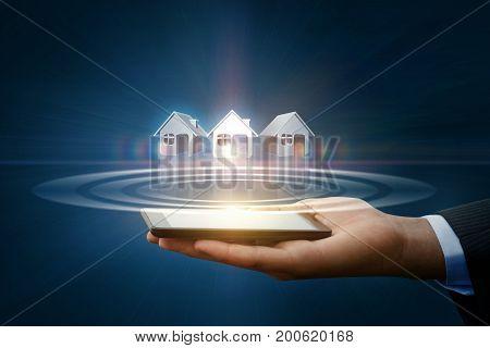 Businessman Shows Houses.