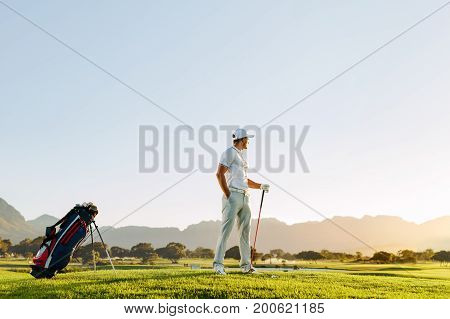 Professional Male Golfer With Golf Club At Course