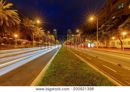 View of the avenue leading to the port Olympus in the night illumination. Barcelona. Spain.