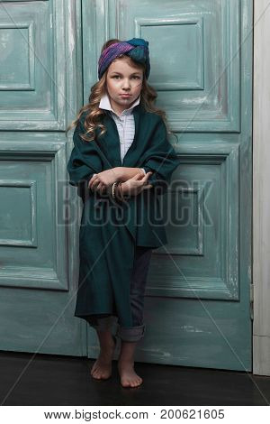 beautiful little charming girl child posing in bright fashionable clothes in oriental style