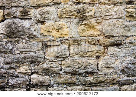 Old brown gray and ocher stone bricks