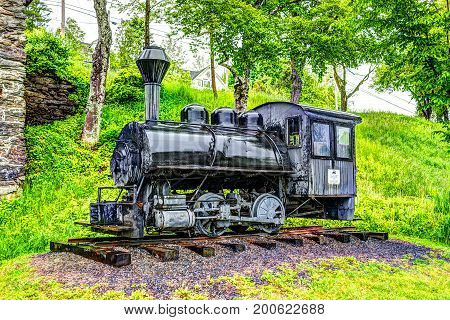 Rockport USA - June 9 2017: Vulcan steam locomotive train car antique gift from Wilkes-Barre PA town in park in Maine
