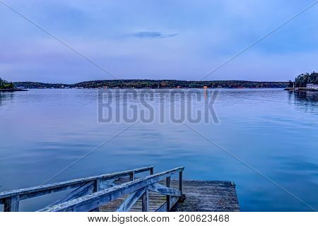 Sunset In Evening At Boothbay Harbor In Small Village In Maine With Wooden Dock
