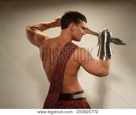 The buff guy is wearing a highlander outfit.