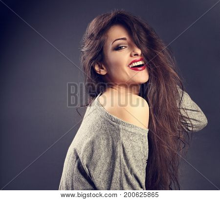 Happy Beautiful Brunette Woman With Long Hair Style In Grey Fashion Sweater Looking With Toothy Smil