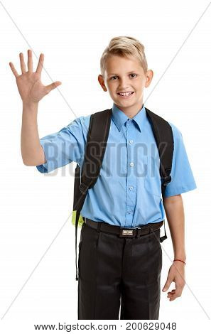 Young happy smiling schoolboy showing one palm