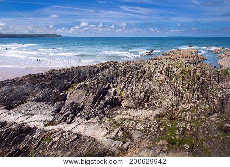 Coastal rocks visible at low tide. Beautiful coast in Woolacombe. Devon. England