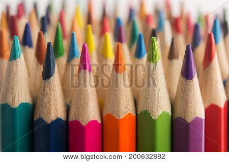 Assortment of Colored drawing pencils in a variety of colors macro.