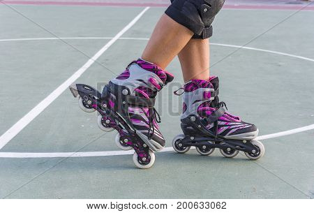 Roller skate legs close up. Rollers on the legs sport