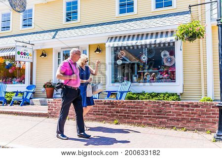 Kennebunkport USA - June 10 2017: Souvenir shop entrance by sidewalk street with people walking in downtown village during summer day
