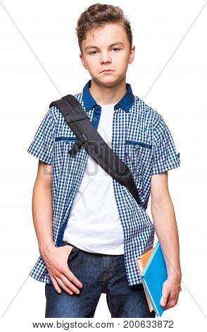 Portrait of young student with school bag and notebooks. Teenager looking at camera. Unhappy teen boy, isolated on white background.