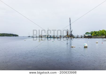 Belfast USA - June 9 2017: Empty marina harbor in small village in Maine during rain with boats and beach