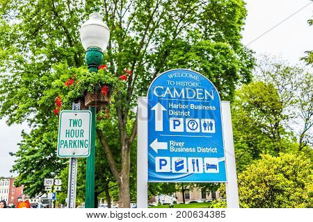 Camden USA - June 9 2017: Downtown small village in Maine during rain with direction sign for business district and two hour parking