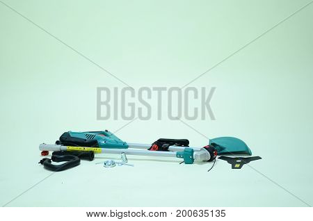 weed trimmer, lawn mower, brush cutter, closeup, isolated on white background, clipping path included