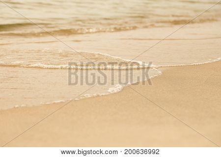 sea sandy shoreline closeup background with copy space