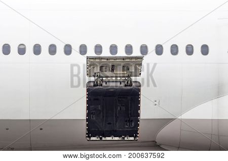 Luggage compartment and cargo section in the airplane open on inspection