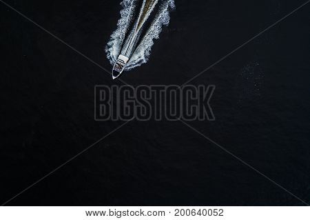 Two yachts are rafted along the Dnieper River. Sailing sport. Competitions on the water. Top view. Aerial view