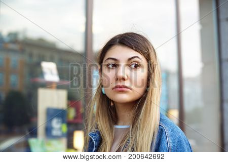 Hipster girl with blonde hair and nose-ring walking on streets of big city sightseeing visiting local curiousities while spending summer vacations in foreign country. People travel and holidays