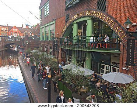 Birmingham, United Kingdom - August 5, 2017: Birmingham Canals - Brindley Place, tourists and locals enjoying a summer evening